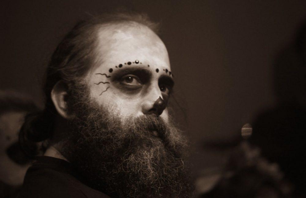 beared man with halloween makeup